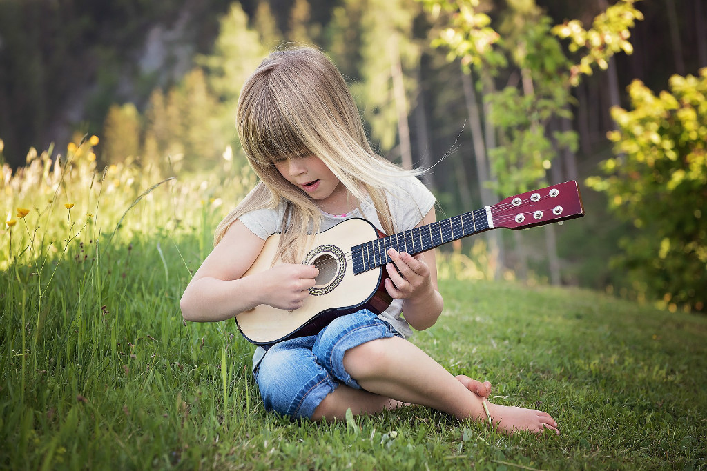 How should kids learn to play the guitar?